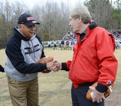 Willie Jeffries (left) shakes hands with Dick Sheridan before last week's SCISA all-star football game in Orangeburg. (Christopher Huff/Times and Democrat)