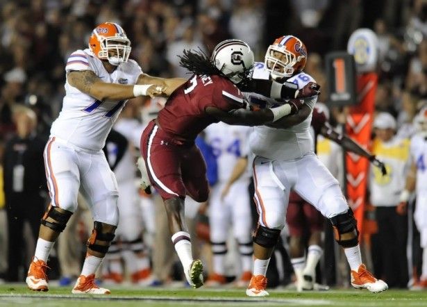 Florida lineman Max Garcia (right), here battling South Carolina's Jadeveon Clowney last year, will play in the Medal of Honor Bowl. (AP Photo/ Richard Shiro)