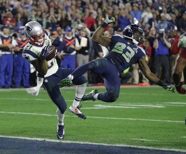 New England strong safety Malcolm Butler (21) intercepts a pass intended for Seattle wide receiver Ricardo Lockette (83) in the final minute of Sunday's Super Bowl to secure the Patriots' 28-24 victory.(AP Photo/Kathy Willens)